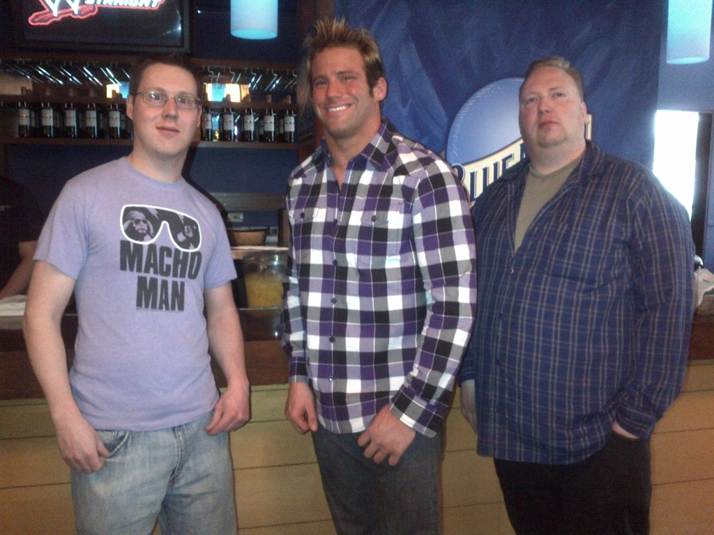 Addie and Mo join Zack Ryder over by the alcohol.    Addie promised him they wouldn't be as high maintenance as the guy before who wanted 2 photos with poses. Mo made sure to thank Zack for teaching him to spike his hair, which seemed to confuse Ryder