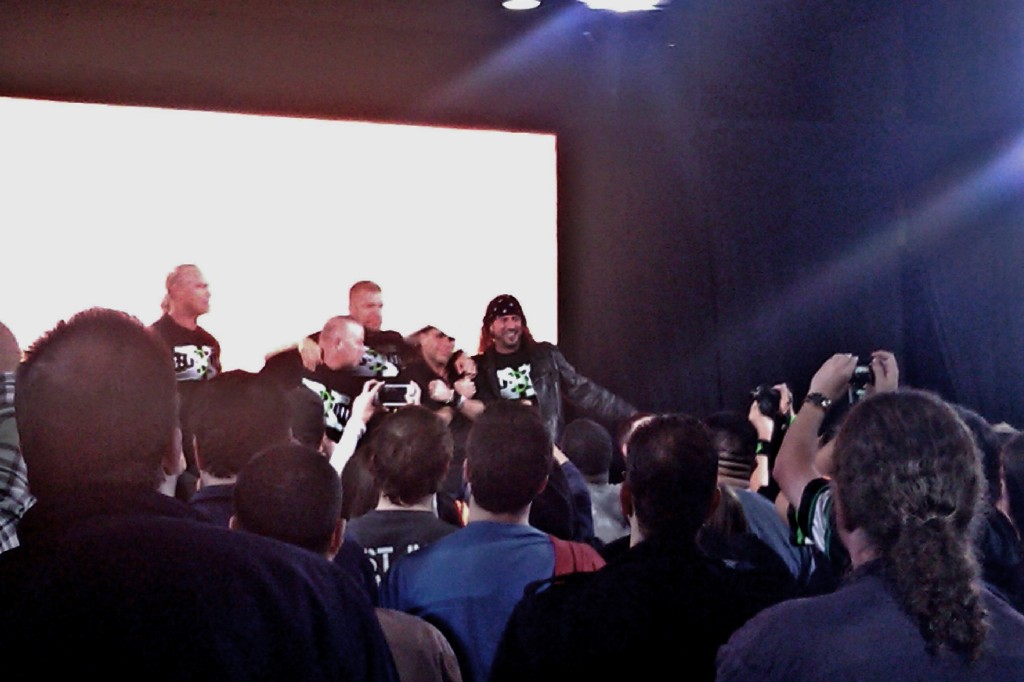 "All of DX posing together giving the DX Chop. Also, everyone but Shawn Michaels said ""Suck It""! He found religion you know"
