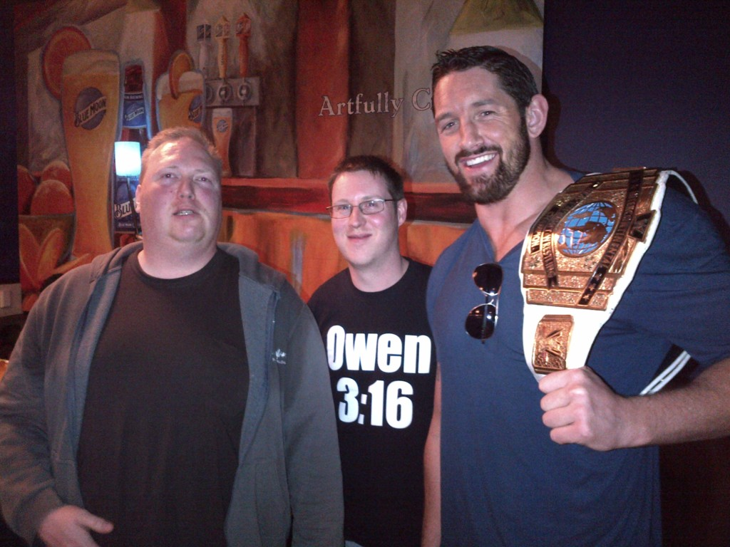 """Mo & Addie with Wade Barrett, who's a hell of a lot bigger than we realized. Mo told him people often confuse him for being Wade's twin, which caused Barrett to give Mo a strange look and sort of laugh and say """"Oh... uh, Yeah, my twin"""""""