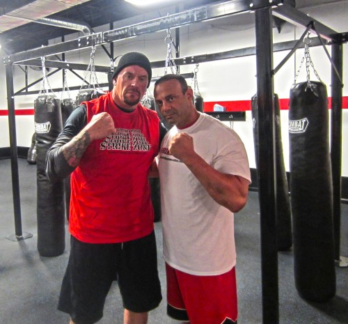 Speaking of a gym, here's The Undertaker with MMA trainer Dave Paladino.
