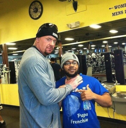 And here at a gym pretending to choke slam a fan... At least I hope he was pretending.