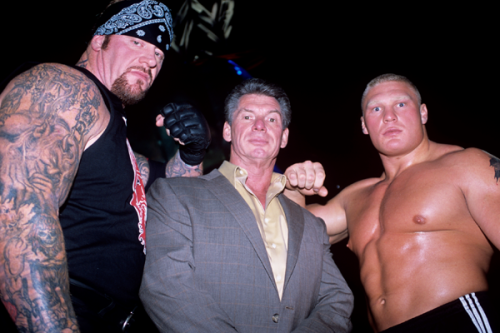Mark, Vince McMahon, and a young, fresh faced, but still scary looking Brock Lesnar.