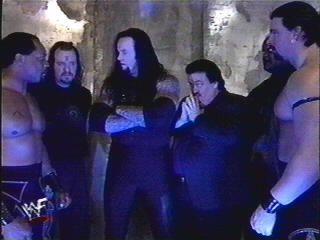 9806 - A.P.A. Dennis_Knight Ministry_Of_Darkness arms_folded backlash faarooq john_bradshaw_layfield mideon paul_bearer ron_simmons undertaker viscera wwf