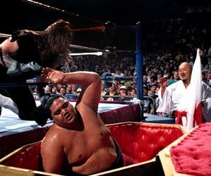 After feuding with various big men like Kamala and Giant Gonzalez over the next few years Taker was finally put back into the WWF Heavyweight Title picture in the 1994 Royal Rumble, a casket match, with Yokozuna.